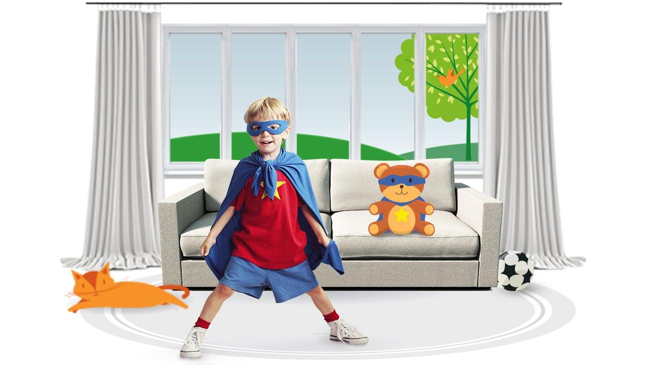Boy wearing a superhero suit indoors.